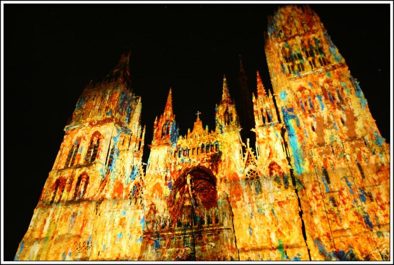 Monet-inspired lighting show on the front facade of a cathedral